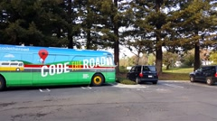 Google's code the road bus in front of Google office Stock Footage