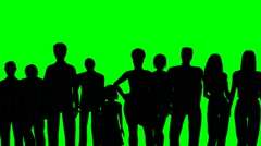 Group of people in silhouette on a green screen Arkistovideo