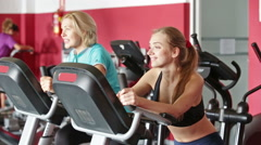 Elderly and young women working out in gym for female Stock Footage
