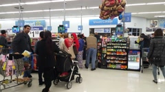 People shopping at Walmart supermarket store - stock footage