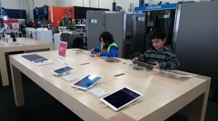 Apple iPad on display in Apple store in Palo Alto, CA - stock footage