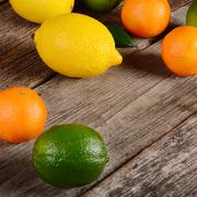 Allsorts from a citrus on wooden background Stock Photos