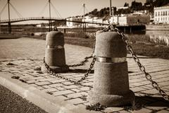 Stub posts linked in a chain on a quay Stock Photos