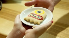 The hands take cookies Stock Footage