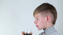 Boy drinking a carbonated beverage - stock footage