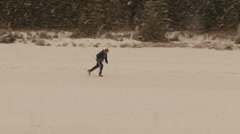 Winter in Banff, skating on river with skates hockey Stock Footage