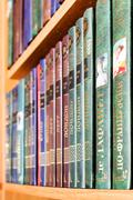 Books in Russian on a bookshelf. editorial use only Stock Photos