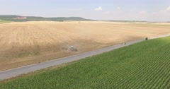 Two bikers on a road in the flatlands Aerial 4K Stock Footage
