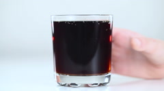 Take glass carbonated beverage Stock Footage
