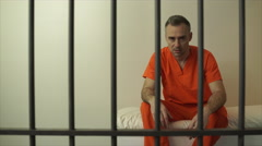 Scene of an enraged inmate in prison - stock footage