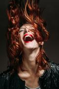 Portrait of a redhead woman. Stock Photos