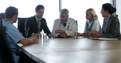 Businessman talking to a medical team Stock Footage