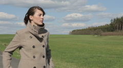 Young woman standing in a park and enjoying the nice weather Stock Footage