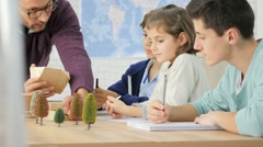 School teacher in science class with pupils Stock Footage