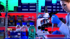 Female Scientist Looking Through Microscope Stock Footage