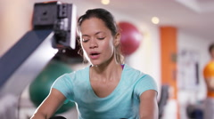 4K Woman working out on rowing machine at the gym Stock Footage