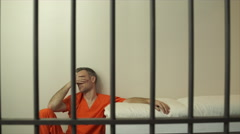 Scene of a miserable inmate in prison Stock Footage