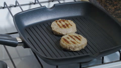 Cutlets are fried in bbq pan Stock Footage