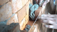 Labor making a brick wall with soil brick and cement step by step, 4K Stock Footage