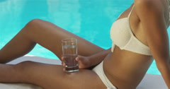 Stock Video Footage of Woman in white bikini holding glass of water