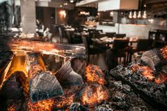 Modern restaurant with fireplace Stock Photos