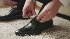 Businessman putting on shoes Stock Footage