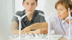 Closeup of teens at school learning about wind power - stock footage