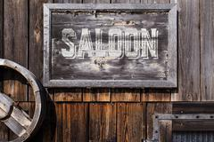 Wooden sign with word saloon Stock Photos