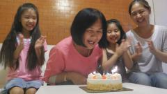 Asian Senior woman celebrating birthday with family - stock footage