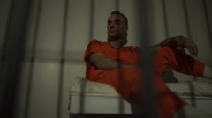 Scene of a gloomy inmate in prison - stock footage