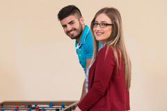 Friends Playing Soccer Table - Foosball - stock photo