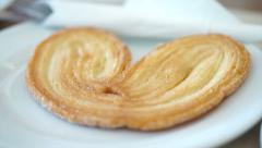 Video of Puff elephant ear pastry, palmier serve on plate in cafe Stock Footage
