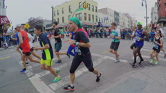 Runners racing through Brooklyn in the New York City Marathon. Stock Footage