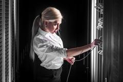 Young engineer businesswoman in server room Kuvituskuvat