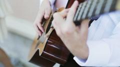 Man playing guitar, close up Stock Footage