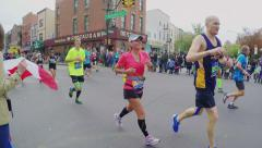 Spectator's pov of runners racing in marathon - stock footage