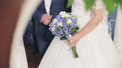 Bride with bouquet of pink flowers and groom in blue suit together on wedding Stock Footage