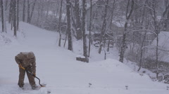 View of a man shoveling snow Stock Footage