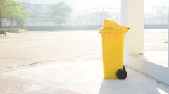 Boy carry garbage bag and drop in the yellow bin - stock footage