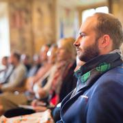 Entrepreneur in audience at business conference. - stock photo