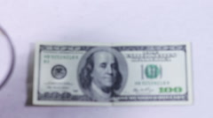 One Hundred Dollars Under The Magnifying Glass Stock Footage