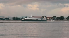 Ferry-Catamaran Sails on a Background of the City Stock Footage