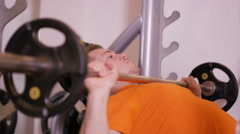 4K Muscular man working out with weights at the gym - stock footage