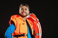 Stock Photo of Lifeguard in life vest with ring buoy lifebuoy.