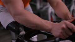 4K Close up of man with prosthetic leg working out on exercise bike at the gym.  Stock Footage