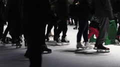 Crowd of people ice skating at night Stock Footage