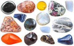 Many tumbled ornamental gem stones isolated Stock Photos