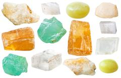 various calcite gem stones isolated on white - stock photo
