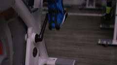 4K Close up of man working out on exercise bike at the gym - stock footage