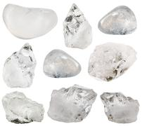 Rock crystal (clear quartz) stone and tumbled gems Stock Photos